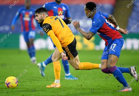 Pedro Neto (L) of Wolverhampton in action against Nathaniel Clyne (R) of Crystal Palace during the English Premier League soccer match between Crystal Palace and Wolverhampton Wanderers in London, Britain, 30 January 2021.