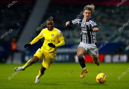 Fulham's Ademola Lookman, left, and West Bromwich Albion's Kamil Grosicki challenge for the ball during the English Premier League soccer match between West Bromwich Albion and Fulham at the Hawthorns stadium in West Bromwich, England, Saturday, Jan.30, 2021