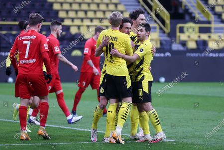 Thomas Delaney of Borussia Dortmund celebrates with team mates Julian Brandt, Raphael Guerreiro and Mats Hummels after scoring their side's first goal during the Bundesliga match between FC Bayern Muenchen and TSG Hoffenheim at Allianz Arena in Munich, Germany, 30 January 2021.