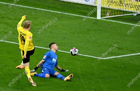 Dortmund's Julian Brandt (L) misses a goal against Augsburg's goalkeeper Rafal Gikiewicz (R) during the German Bundesliga soccer match between Borussia Dortmund and FC Augsburg in Dortmund, Germany, 30 January 2021.