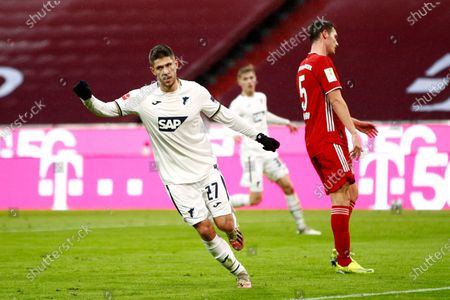 Andrej Kramaric of TSG 1899 Hoffenheim celebrates after scoring his team's first goal during the German Bundesliga soccer match between FC Bayern Muenchen and TSG Hoffenheim at Allianz Arena in Munich, Germany, 30 January 2021.