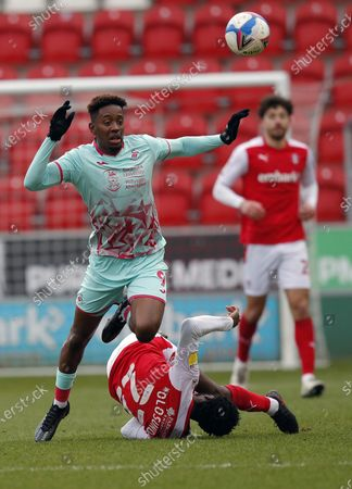 Jamal Lowe of Swansea leaps over Matthew Olosunde of Rotherham United