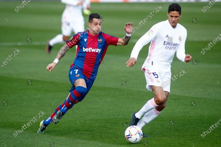 Stock Picture of Sergio Leon of Levante and Raphael Varane of Real Madrid in action during the spanish league, La Liga Santander, football match played between Real Madrid and Levante UD at Ciudad Deportiva Real Madrid on january 30, 2021, in Valdebebas, Madrid, Spain.