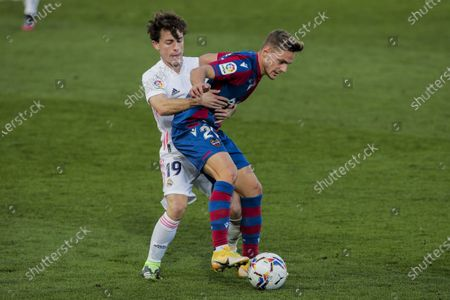Real Madrid's Alvaro Odriozola, left, duels for the ball with Levante's Jorge Miramon during the Spanish La Liga soccer match between Real Madrid and Levante at the Alfredo Di Stefano stadium in Madrid, Spain