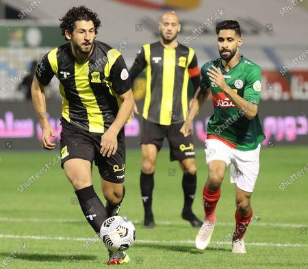 Al Ittifaq player Hazzaa Al Hazzaa (R) in action against Al Ittihad player Ahmed Hegazi during the Saudi Professional League soccer match between Al Ittifaq and Al Ittihad at Prince Mohamed bin Fahd Stadium, in Dammam, Saudi Arabia, 30 January 2021.