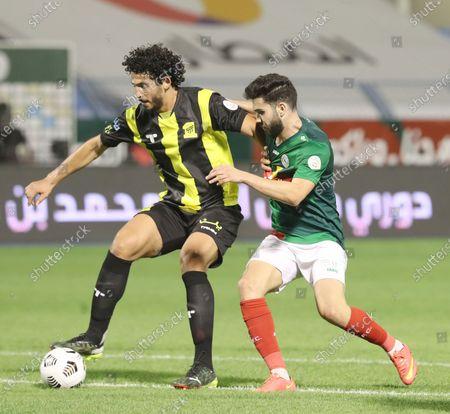 Al Ittifaq player Walid Azarou (R) in action against Al-Ittihad player Ahmed Hegazi (L) during the Saudi Professional League soccer match between Al Ittifaq and Al Ittihad at Prince Mohamed bin Fahd Stadium, in Dammam, Saudi Arabia, 30 January 2021.