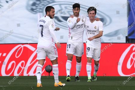 Real Madrid's striker Marco Asensio (C) celebrates with teammates Eden Hazard (L) and Alvaro Odriozola (R) after scoring the 1-0 lead during the Spanish LaLiga soccer match between Real Madrid and Levante UD held at Alfredo Di Stefano stadium, in Madrid, central Spain, 30 January 2021.