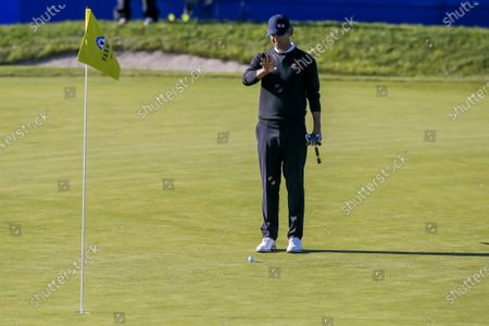 Adam Scott of Australia putts on the 18th green during the third round of the Farmers Insurance Open at Torrey Pines Golf Course in San Diego, California, USA, 30 January 2021