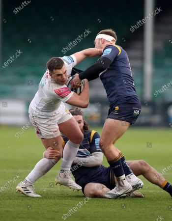 Stock Image of Joe Simmonds of Exeter is tackled by Perry Humphreys (headband) and Oli Morris of Worcester