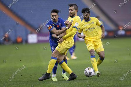 Al Nassr player Petros (2-R) in action against Al Hilal player Salem Al-Dawsari (L) during the Saudi Super Cup match between Al Hilal and Al Nassr at King Fahd International Stadium, Riyadh, Saudi Arabia, 30 January 2021.