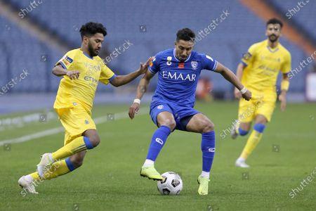 Al Hilal player Salem Al-Dawsari (2-L) in action against Al Nassr player Khalid Al Ghannam (L) during the Saudi Super Cup match between Al Hilal and Al Nassr at King Fahd International Stadium, Riyadh, Saudi Arabia, 30 January 2021.