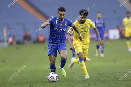 Al Hilal player Salem Al-Dawsari (L) in action against Al Nassr player Khalid Al Ghannam (R) during the Saudi Super Cup match between Al Hilal and Al Nassr at King Fahd International Stadium, Riyadh, Saudi Arabia, 30 January 2021.