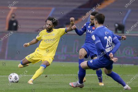 Al Nassr player Abdulmajeed Al-Sulaiheem (L) in action against Al Hilal player Jang Hyun-Soo (R) during the Saudi Super Cup match between Al Hilal and Al Nassr at King Fahd International Stadium, Riyadh, Saudi Arabia, 30 January 2021.