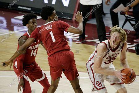 Brady Manek (35) looks to shoot against Alabama's Herbert Jones (1) and Keon Ellis (14) during the second half of an NCAA college basketball game in Norman, Okla