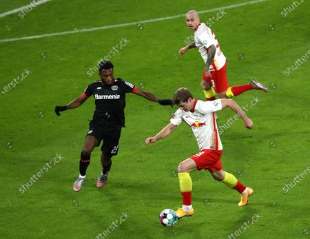 Alexander Soerloth of RB Leipzig  is put under pressure by Timothy Fosu-Mensah of Bayer Leverkusen  (L) during the Bundesliga match between RB Leipzig and Bayer 04 Leverkusen at Red Bull Arena in Leipzig, Germany, 30 January 2021.