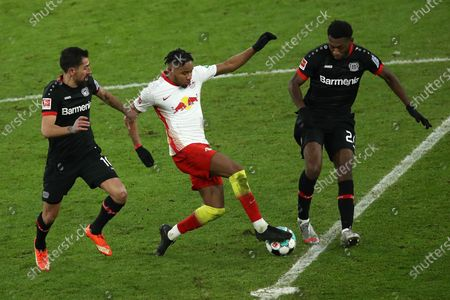 Christopher Nkunku of RB Leipzig  is put under pressure by Kerem Demirbay (L) and Timothy Fosu-Mensah (R) of Bayer Leverkusen during the Bundesliga match between RB Leipzig and Bayer 04 Leverkusen at Red Bull Arena in Leipzig, Germany, 30 January 2021.