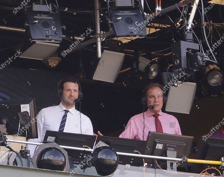 Tony Romo and Jim Nantz work in the broadcast booth before an NFL football game between the Green Bay Packers and the Cincinnati Bengals in Green Bay, Wis. Nantz and Romo were inseparable when CBS broadcast the Super Bowl two years ago. Next week, they won't see each other until they are in the broadcast booth a couple hours prior to kickoff. Keeping announcers separated until game day has been standard practice this season due to the Coronavirus pandemic