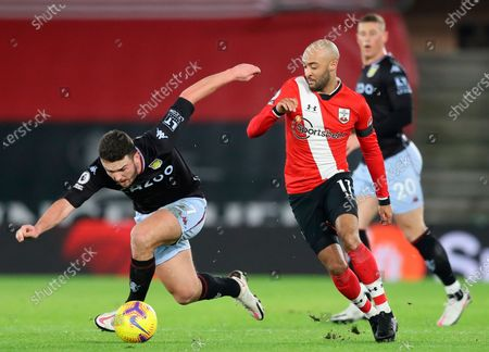 Aston Villa's John McGinn (L) in action against Southampton's Nathan Redmond (R) during the English Premier League soccer match between Southampton FC and Aston Villa in Southampton, Britain, 30 January 2021.
