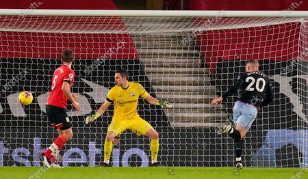 Aston Villa's Ross Barkley (R) scores the 0-1 goal past Southampton goalkeeper Alex McCarthy (C) during the English Premier League soccer match between Southampton FC and Aston Villa in Southampton, Britain, 30 January 2021.