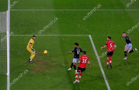 Aston Villa's Ross Barkley (R) scores the 0-1 goal past Southampton goalkeeper Alex McCarthy (L) during the English Premier League soccer match between Southampton FC and Aston Villa in Southampton, Britain, 30 January 2021.