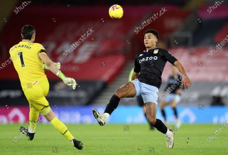 Southampton's goalkeeper Alex McCarthy clears the ball from Aston Villa's Ollie Watkins during the English Premier League soccer match between Southampton and Aston Villa at St. Mary's Stadium in Southampton, England