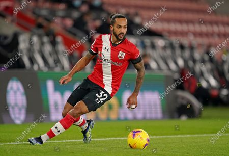 Southampton's Theo Walcott runs with the ball during the English Premier League soccer match between Southampton and Aston Villa at St. Mary's Stadium in Southampton, England