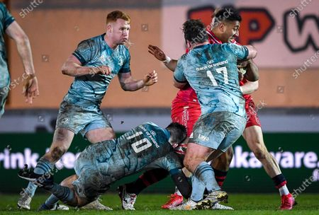 Scarlets vs Leinster. Scarlets' Carwyn Tuipulotu is tackled by Harry Byrne and Ed Byrne of Leinster