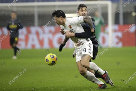 Inter Milan's Andrea Ranocchia, right, fights for the ball wit Benevento's Gianluca Lapadula during a Serie A soccer match between Inter Milan and Benevento at the San Siro stadium in Milan, Italy