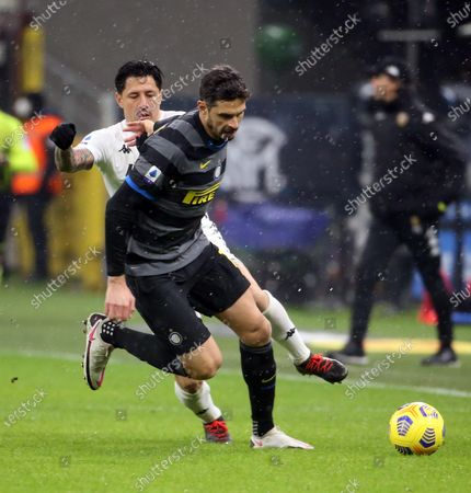 Benevento's Gianluca Lapadula (L) and Inter's Andrea Ranocchia fight for the ball during the Italian serie A soccer match between FC Inter and Benevento Calcio at Giuseppe Meazza stadium in Milan, Italy, 30 January 2021.