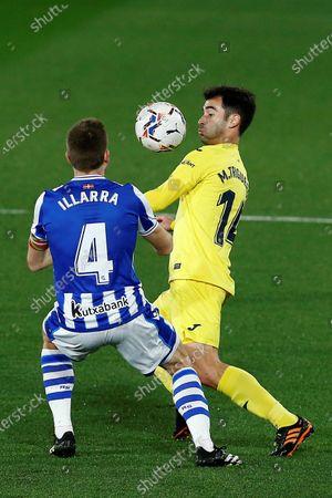 Villarreal's midfielder Manu Trigueros (R) vies for the ball with Real Sociedad's defender Asier Illarramendi (L) during the Spanish LaLiga soccer match between Villarreal CF and Real Sociedad held at La Ceramica stadium, in Villarreal, Spain, 30 January 2021.