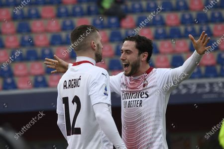 """Ante Rebic (Milan)Davide Calabria (Milan) celebrates after scoring his team's first goal   during the Italian """"Serie A  match between Bologna 1-2 Milan  at  Renato Dall Ara Stadium  on January 30 , 2021 in Bologna, Italy."""