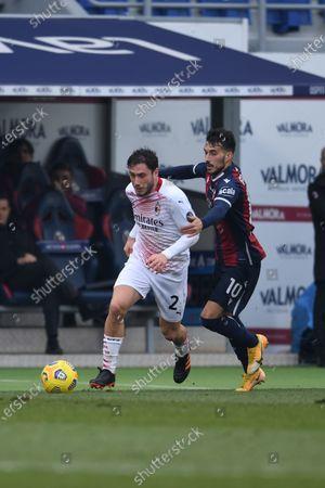 "Davide Calabria (Milan)Nicola Sansone (Bologna)       during the Italian ""Serie A  match between Bologna 1-2 Milan  at  Renato Dall Ara Stadium  on January 30 , 2021 in Bologna, Italy."