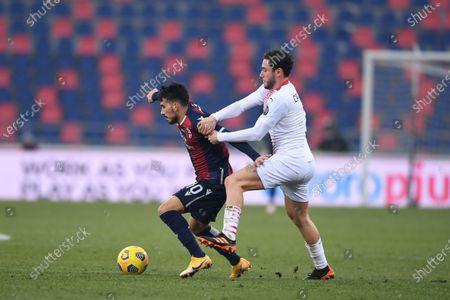 "Nicola Sansone (Bologna)Davide Calabria (Milan)       during the Italian ""Serie A  match between Bologna 1-2 Milan  at  Renato Dall Ara Stadium  on January 30 , 2021 in Bologna, Italy."