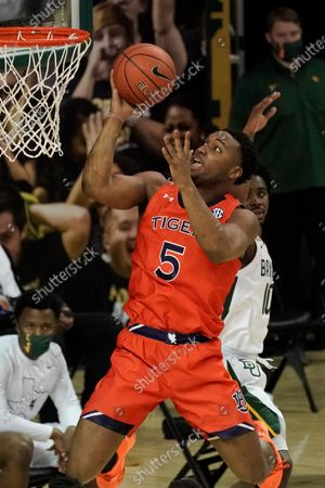 Stock Picture of Auburn's Chris Moore (5) drives past Baylor's Adam Flagler (10) during the first half of an NCAA college basketball game in Waco, Texas