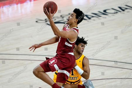 Stanford forward Spencer Jones drives past Arizona State guard Remy Martin (1) during the first half of an NCAA college basketball game, in Tempe, Ariz