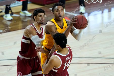 Arizona State forward Kimani Lawrence shoots over Stanford forward Spencer Jones (14) during the first half of an NCAA college basketball game, in Tempe, Ariz
