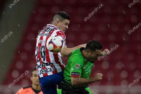 Alan Torres (L) of Chivas in action against Marco Fabian (R) of Juarez during the Liga MX soccer tournament match between Chivas and Suarez at the Akron stadium in Guadalajara, Mexico, 30 January 2021.