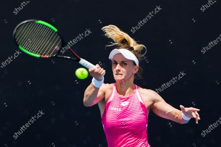 Stock Image of Lesia TSURENKO (UKR) in action against Aliaksandra SASNOVICH (BLR) In a first round match of the Gippsland Trophy Women's Singles tournament prior to the Australian Open Grand Slam tournament in Melbourne, Australia. SASNOVICH won 36 64 64