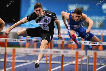 Damian Czykier (L) of Poland and Erik Balnuweit (R) of Germany in action during the men's 60m Hurdles final at the ISTAF Indoor international athletics meeting in Duesseldorf, Germany, 31 January 2021. Czykier won the race.