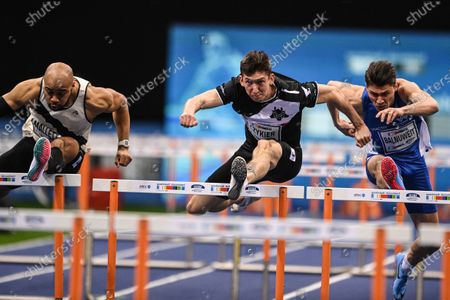 Stock Picture of (L-R) Aaron Mallett of the USA, Damian Czykier of Poland, and Erik Balnuweit of Germany in action during the men's 60m Hurdles final at the ISTAF Indoor international athletics meeting in Duesseldorf, Germany, 31 January 2021. Czykier won the race.