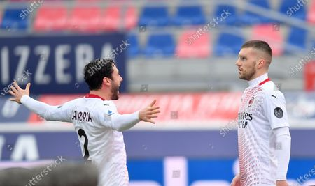 AC Milan's Ante Rebic (R) celebrates with his teammate Davide Calabria during a Serie A football match between Bologna and AC Milan in Bologna, Italy, Jan. 30, 2021.