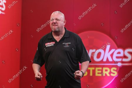 Mervyn King beats Gerwyn Price in the semi-final and celebrates during the PDC Ladbrokes Masters 2021 at Marshall Arena, Milton Keynes