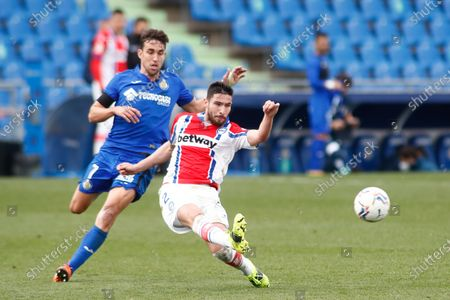 """Alberto Rodriguez """"Tachi"""" of Alaves and Jaime Mata of Getafe in action during the spanish league, La Liga Santander, football match played between Getafe CF and Deportivo Alaves at Coliseum Alfonso Perez on january 31, 2021, in Getafe, Madrid, Spain."""