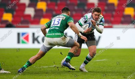 Toby Flood (co-captain) of Newcastle attacks Curtis Rona of London Irish