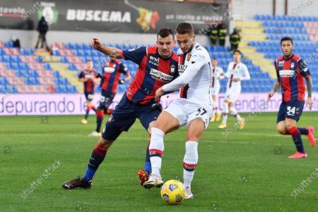 Genoa's Marko Pjaca (R) and Crotone's Vladimir Golemic (L) in action during the Italian Serie A soccer match between FC Crotone and Genoa CFC at Ezio Scida stadium in Crotone, Italy, 31 January 2021.