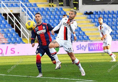 Crotone's Andrea Rispoli (L) and Genoa's Valon Behrami (R) in action during the Italian Serie A soccer match between FC Crotone and Genoa CFC at Ezio Scida stadium in Crotone, Italy, 31 January 2021.