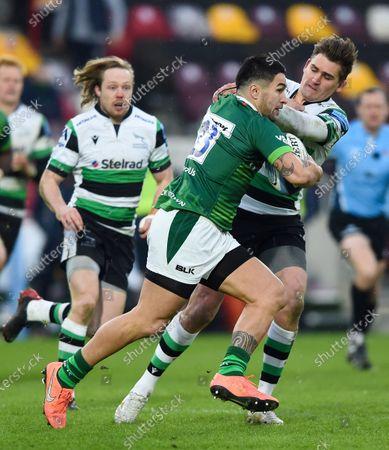 Terrence Hepetema of London Irish fends Toby Flood of Newcastle Falcons