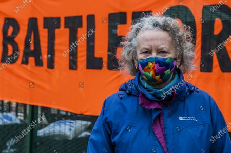Stock Image of Jenny Jones, Baroness Jones of Moulsecoomb, a member of the Green Party joins supporters who arrive with a banner reading 'Stop HS2 Now, #BattleforEuston' - The anti HS2 Extinction Rebellion camp continues to be cleared (in order to create a temporary parking area) by Bailiffs (from the National Enforcement Team, NET, a subsidiary of High Court Enforcement Group) at Euston Station. All the above ground protesters have been cleared and there now seem to be a pause before the tunnels are dealt with.
