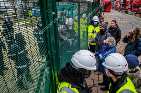 Stock Photo of Jenny Jones, Baroness Jones of Moulsecoomb, a member of the Green Party joins supporters and talks to the site manager for the bailiff operation - The anti HS2 Extinction Rebellion camp continues to be cleared (in order to create a temporary parking area) by Bailiffs (from the National Enforcement Team, NET, a subsidiary of High Court Enforcement Group) at Euston Station. All the above ground protesters have been cleared and there now seem to be a pause before the tunnels are dealt with.
