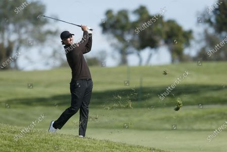 Adam Scott of Australia hits from the rough of the fifth hole during the final round of the Farmers Insurance Open at Torrey Pines Golf Course in San Diego, California, USA, 31 January 2021.